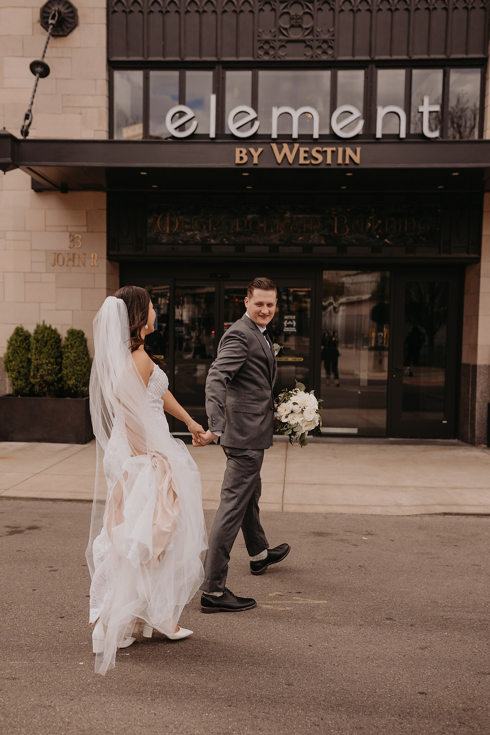Wedding at Element Detroit by Westin in Downtown Detroit. Photographed by Nicole Leanne Photography.