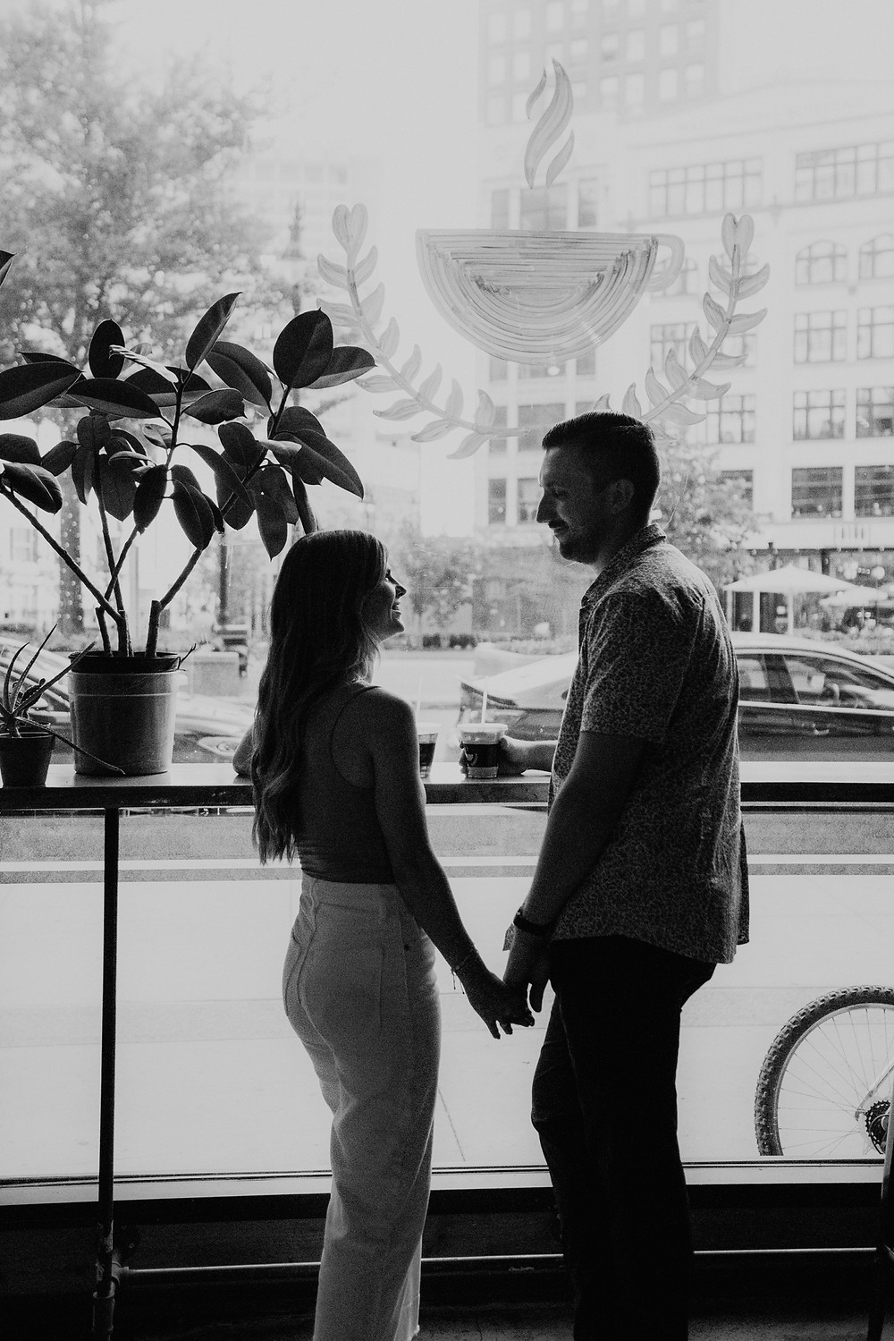 Engagement photos in Detroit Dessert Oasis Coffee Roasters. Photographed by Nicole Leanne Photography.