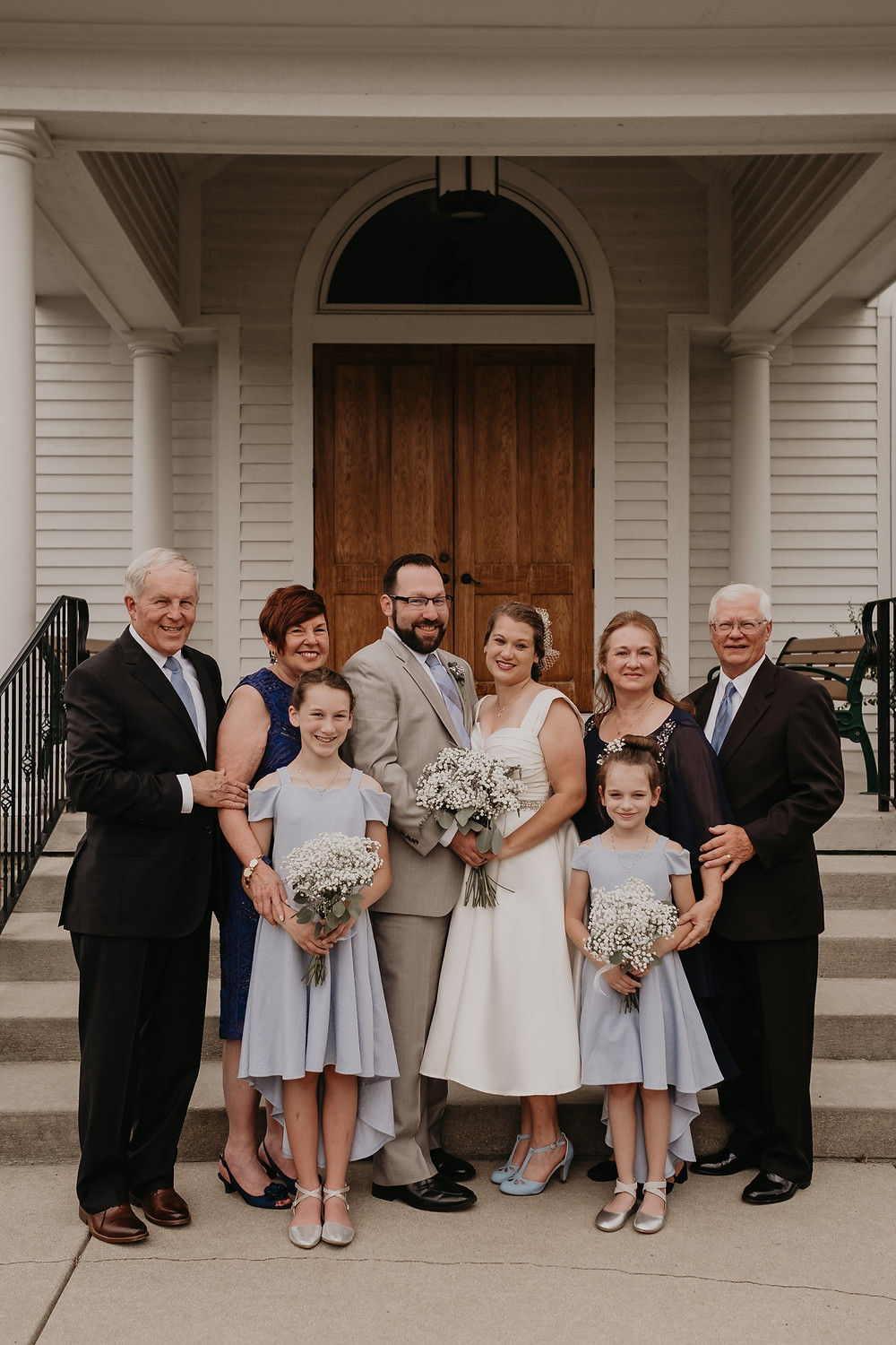 Family portraits after Metro Detroit wedding ceremony. Photographed by Nicole Leanne Photography.