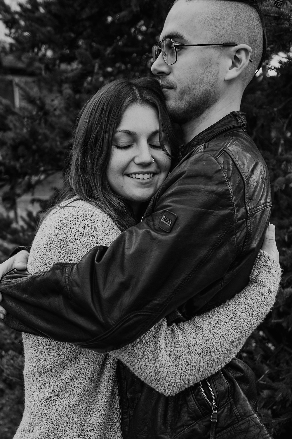 Metro Detroit engagement session with couple hugging. Photographed by Nicole Leanne Photography.