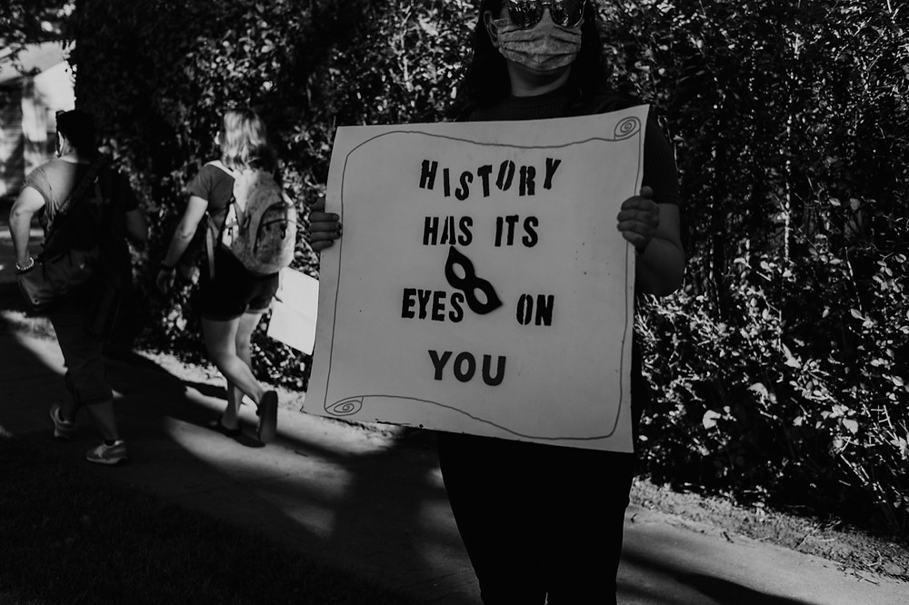History has its eyes on you protest sign in Berkley Michigan