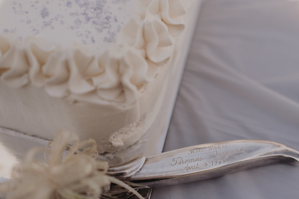 Vintage cake knife at wedding. Photographed by Nicole Leanne Photography.