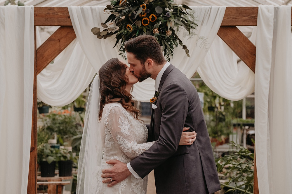 First kiss as husband and wife at Metro Detroit wedding. Photographed by Nicole Leanne Photography.