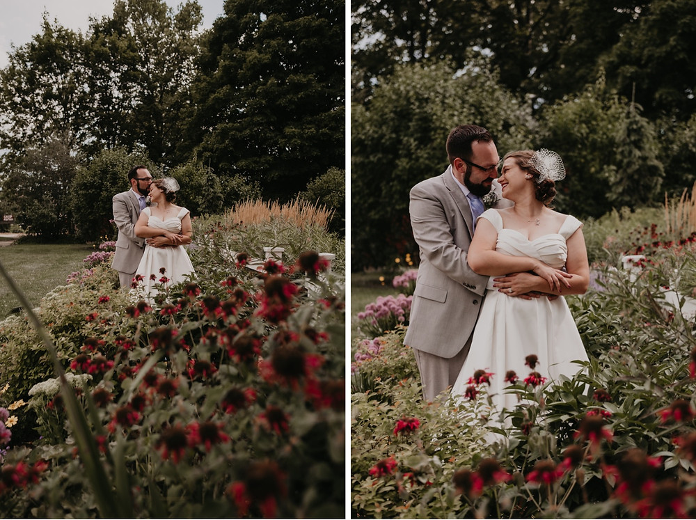 Bride and groom in flower garden for wedding photos in Metro Detroit. Photographed by Nicole Leanne Photography.