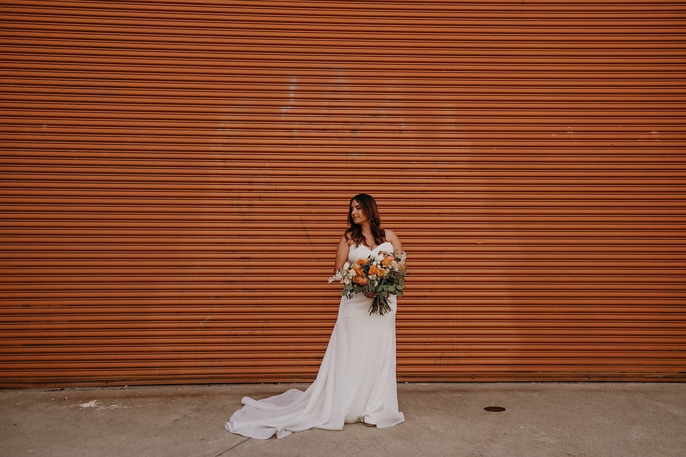 Bridal portrait in Detroit at Eastern Market. Photographed by Nicole Leanne Photography.