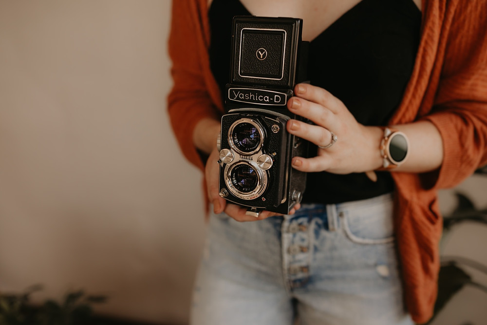Nicole Leanne Photography holding Yashica-D camera.
