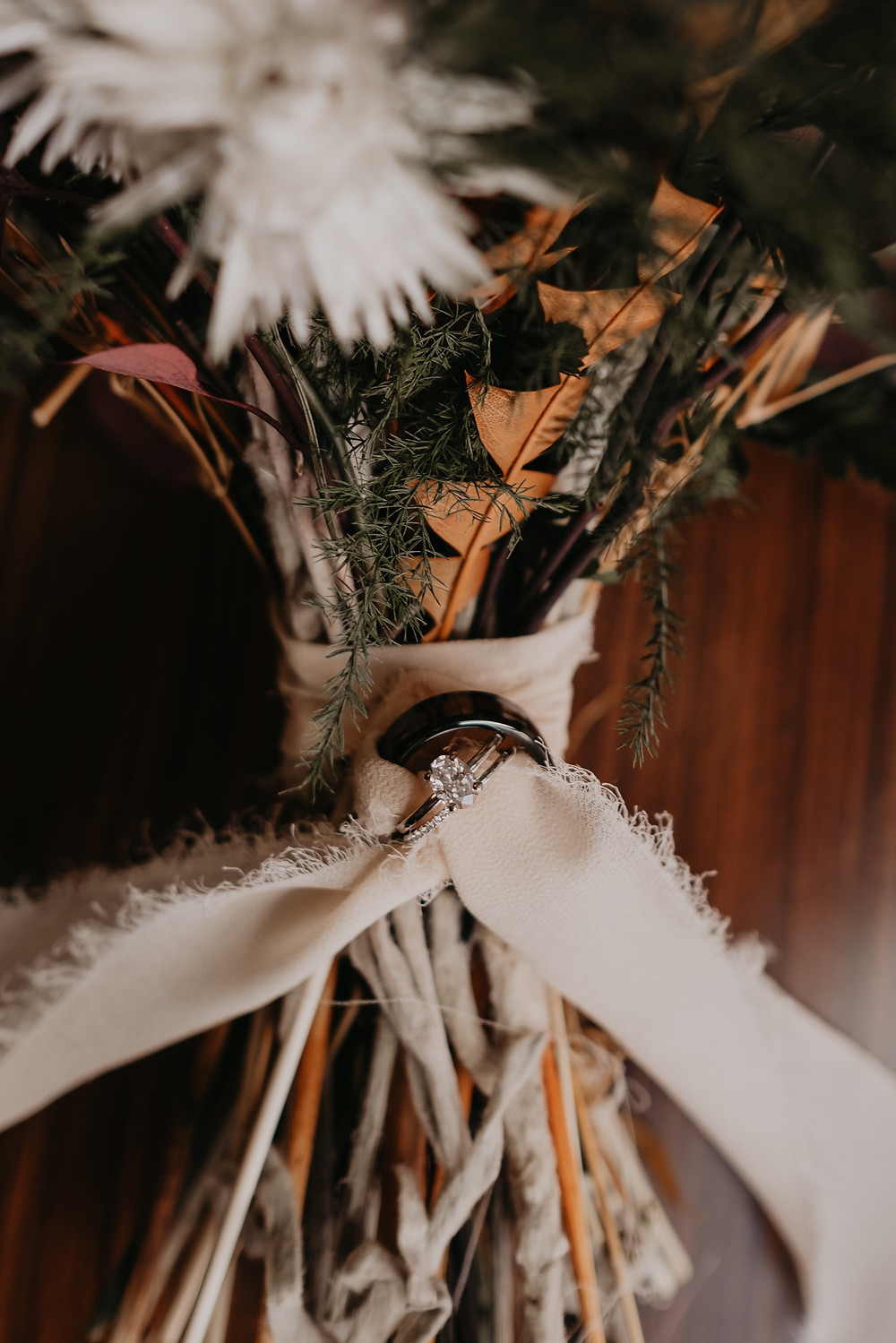 Wedding rings tied around ribbon of bridal bouquet made by The Lost Forty