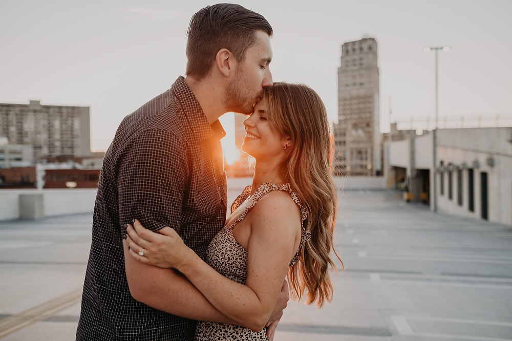 Sunset engagement photos in the city. Photographed by Nicole Leanne Photography.