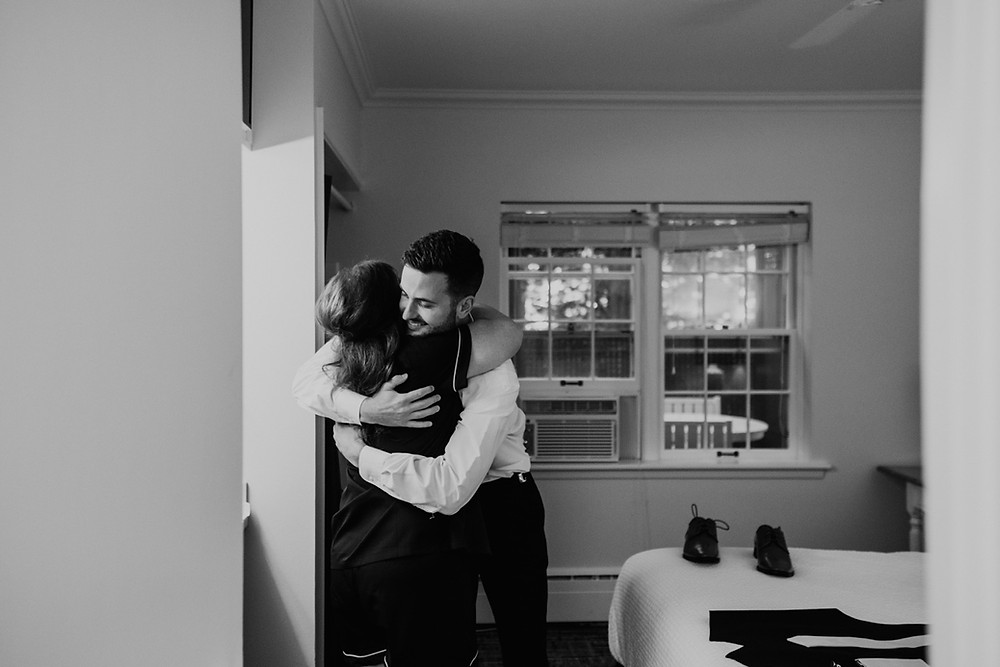 Groom hugging mother on wedding day. Photographed by Nicole Leanne Photography.
