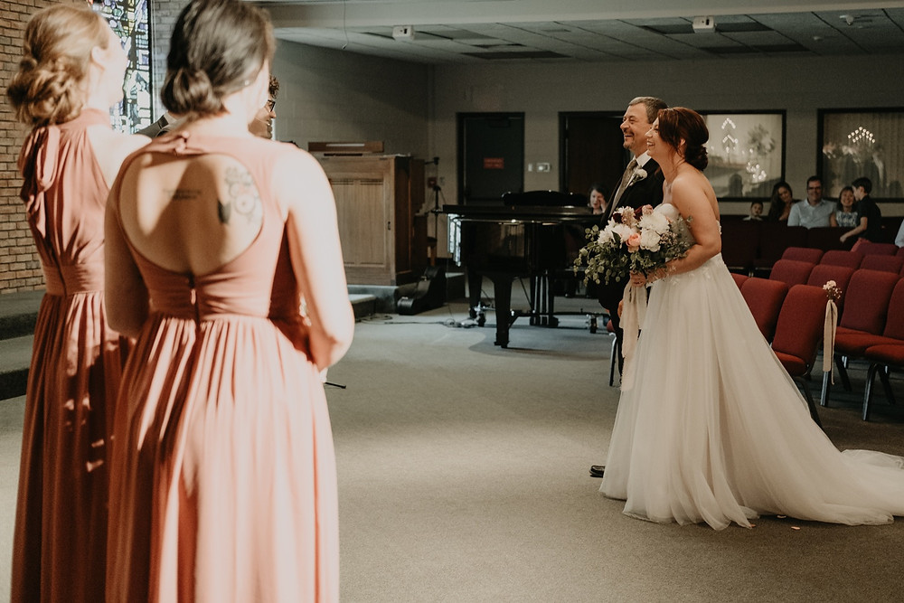 Church wedding ceremony candids. Photographed by Nicole Leanne Photography.