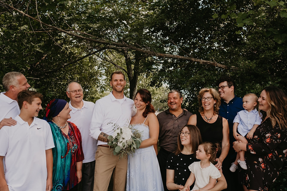 Intimate wedding with guests at park. Photographed by Nicole Leanne Photography.
