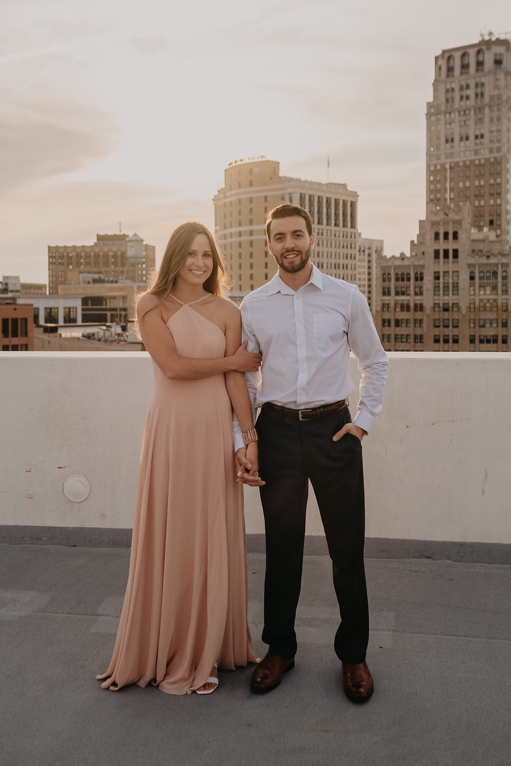 Sunset engagement photos in the city of Detroit. Photographed by Nicole Leanne Photography.