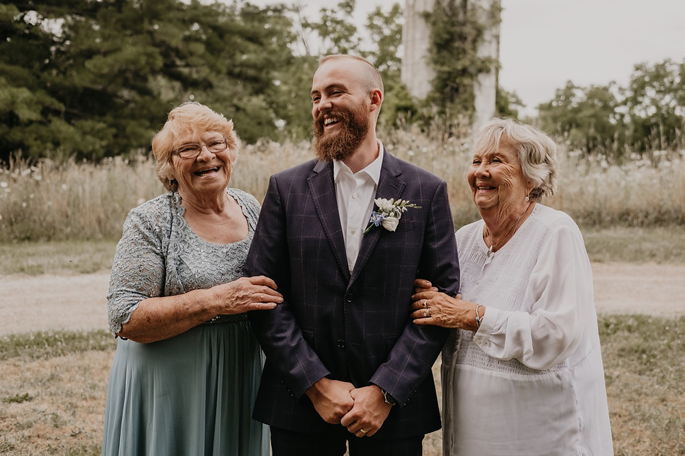 Groom with family members and Michigan intimate wedding. Photographed by Nicole Leanne Photography.