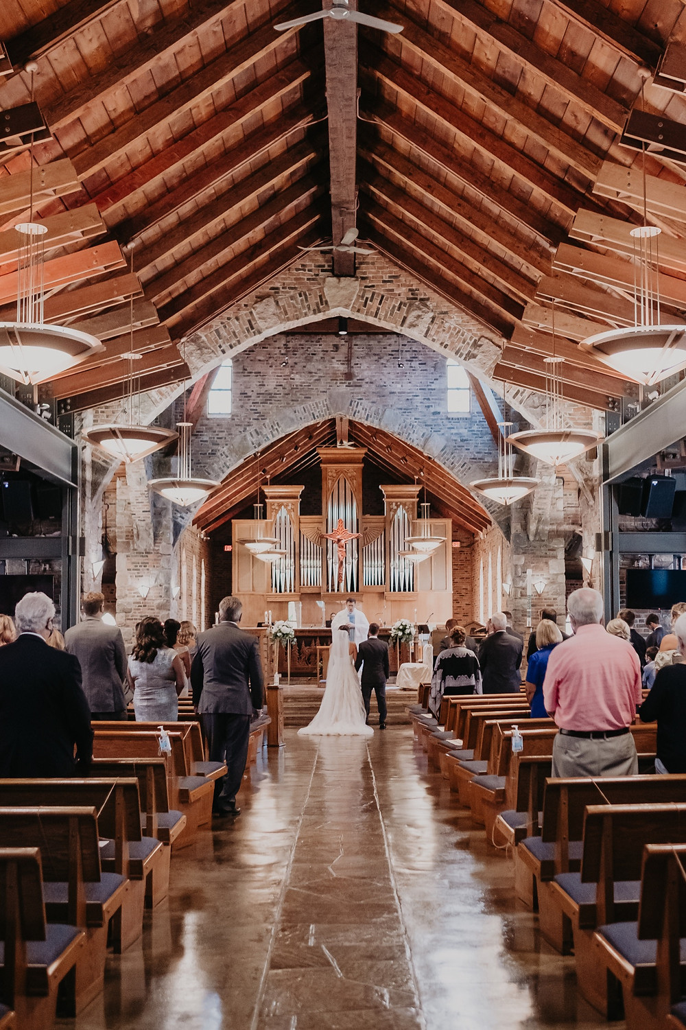 Catholic church wedding in Metro Detroit. Photographed by Nicole Leanne Photography.
