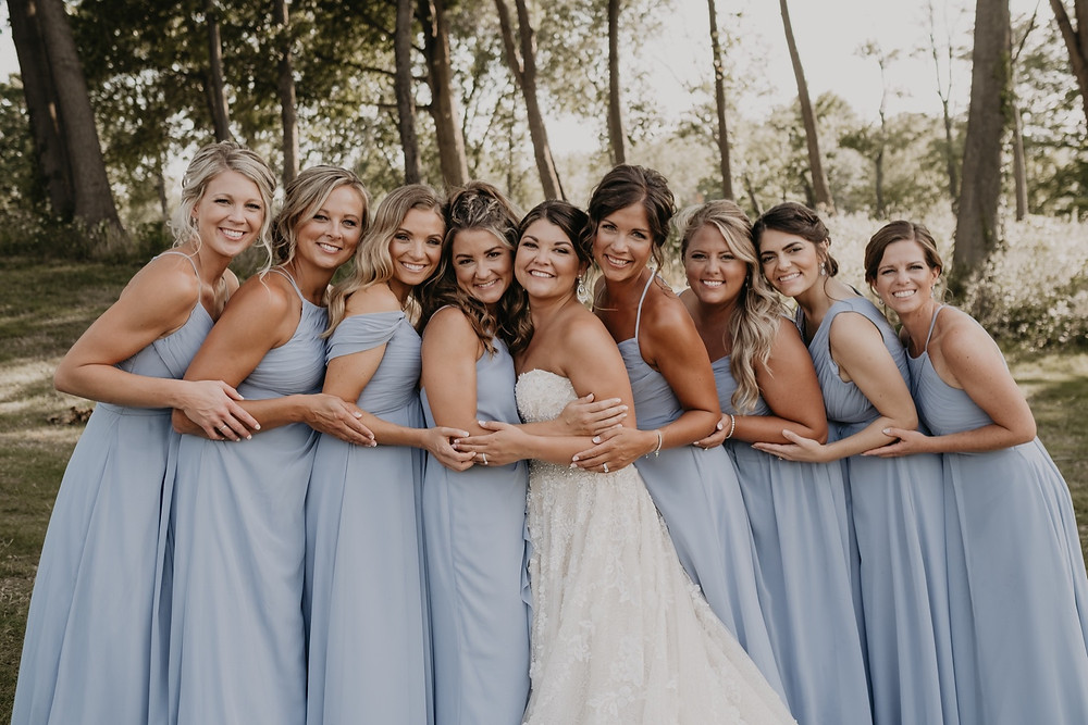 Brides and bridesmaids at summer wedding in Metro Detroit. Photographed by Nicole Leanne Photography.