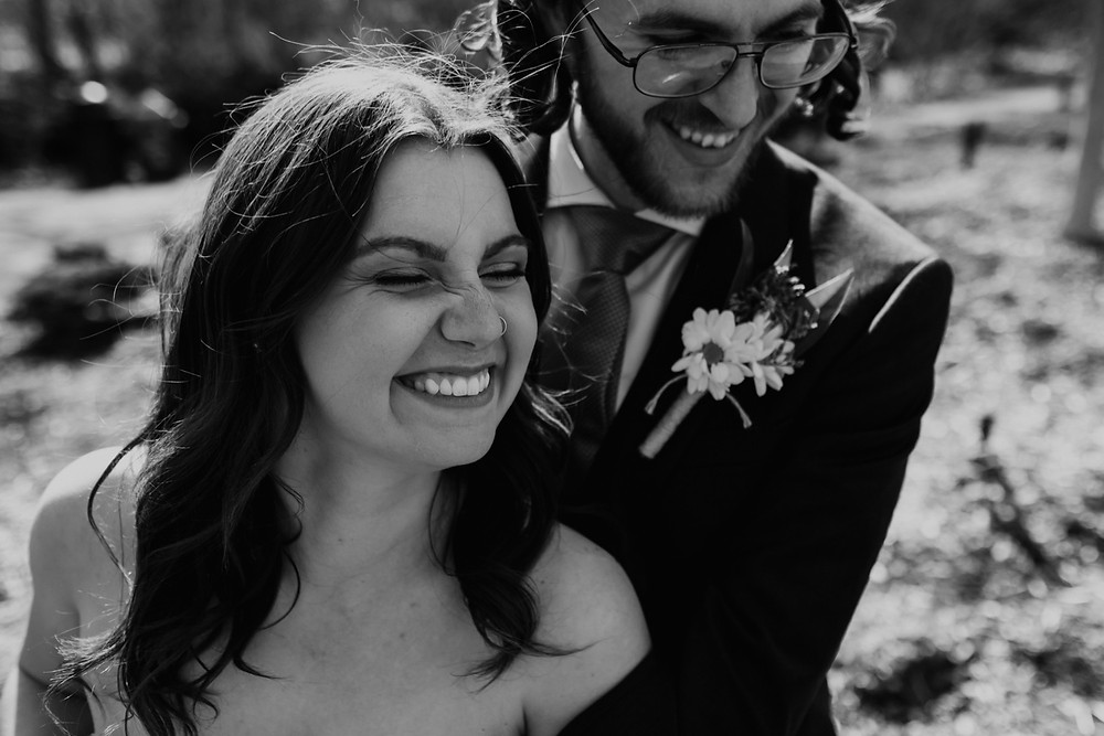 Bride and groom laughing during wedding photos in Metro Detroit.