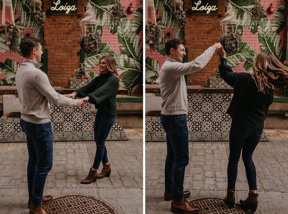 Couple dancing at The Belt alley in Downtown Detroit for engagement photos. Photography by Nicole Leanne Photography