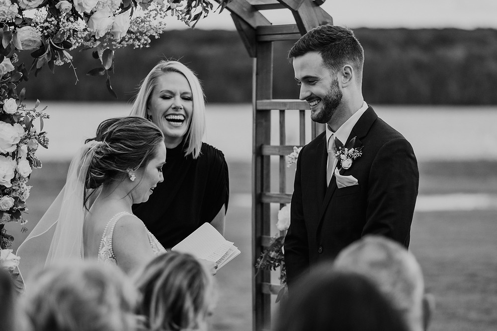 Bride and groom reading vows. Photographed by Nicole Leanne Photography.