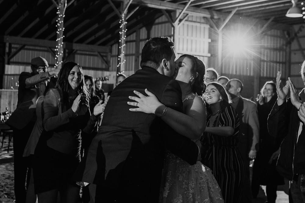 Metro Detroit couple embrace on dance floor at wedding in Allentown