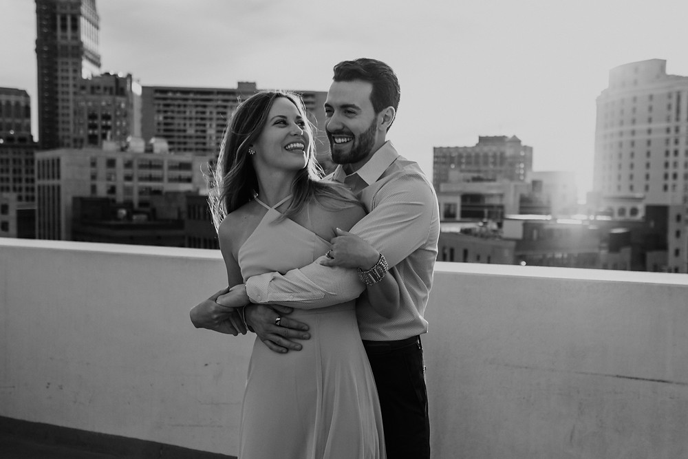 Black and white photo of couple on rooftop. Photographed by Nicole Leanne Photography.