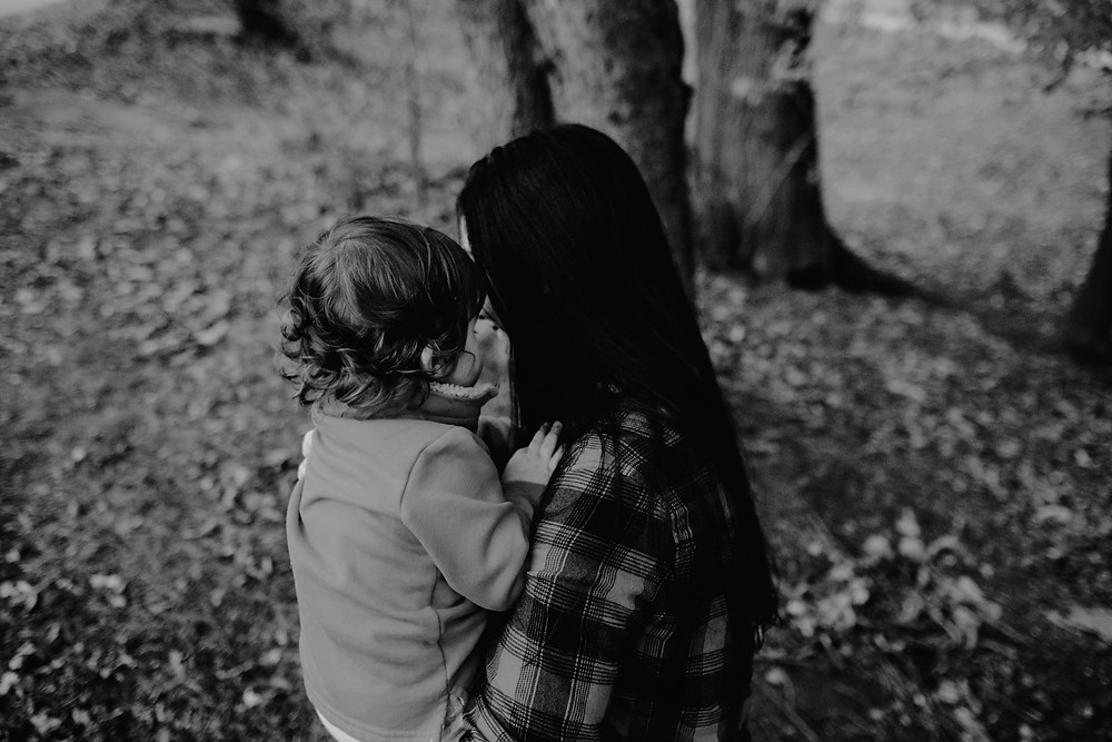 mother holding son, black and white