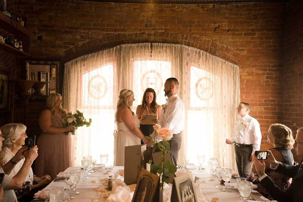 Intimate indoor wedding in Metro Detroit. Photographed by Nicole Leanne Photography