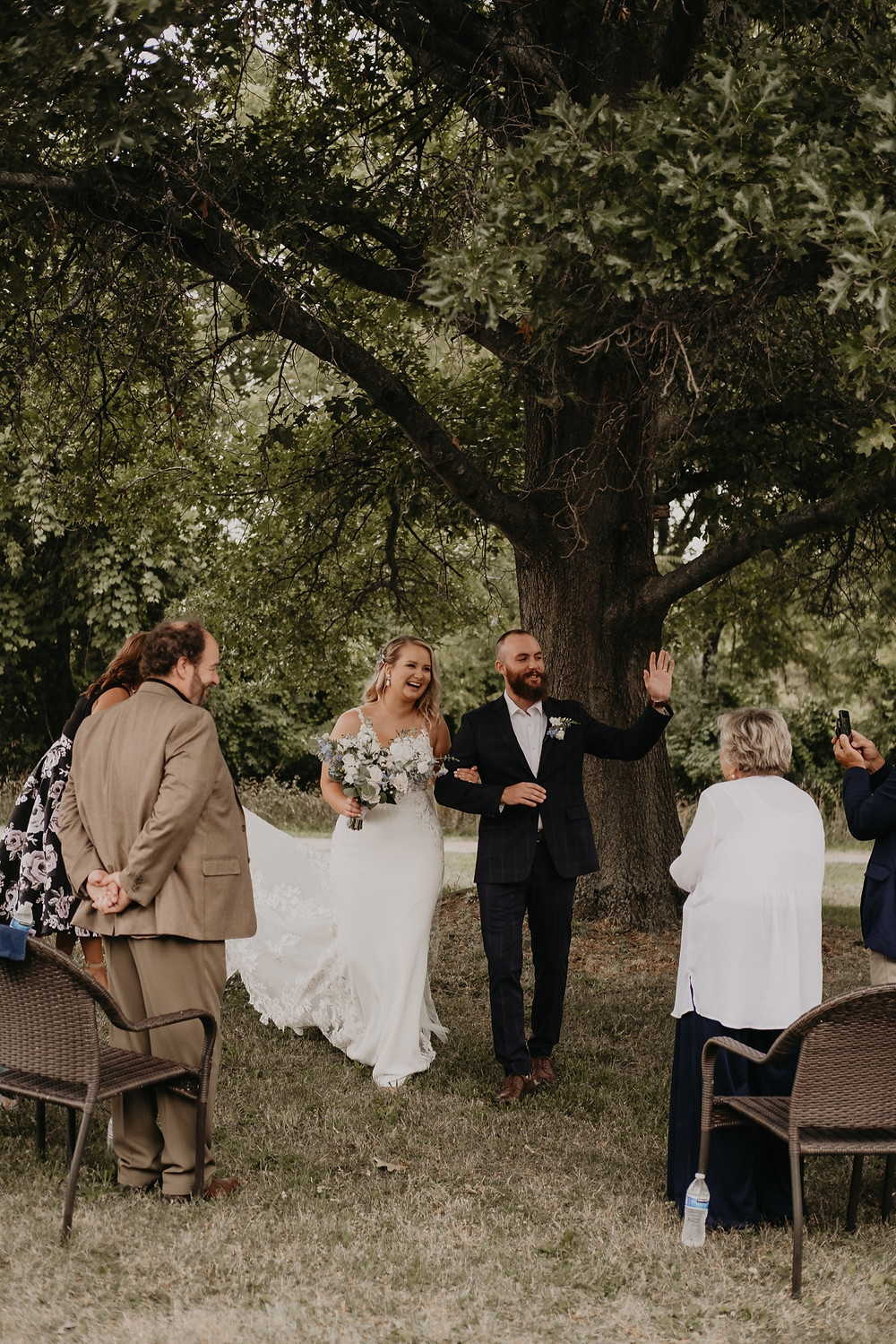 Bride and groom walking down aisle after ceremony. Photographed by Nicole Leanne Photography.