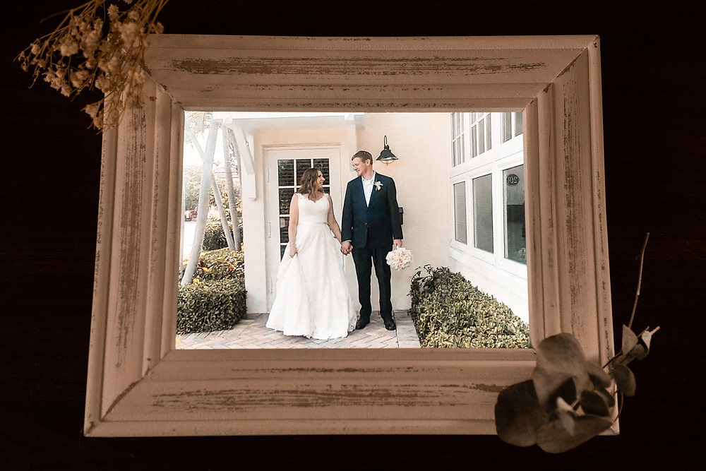 framed photo of bride and groom during pandemic wedding