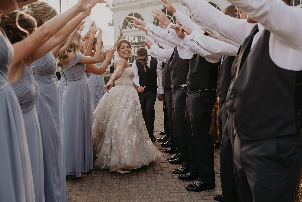 Dancing at wedding reception with wedding party. Photographed by Nicole Leanne Photography.