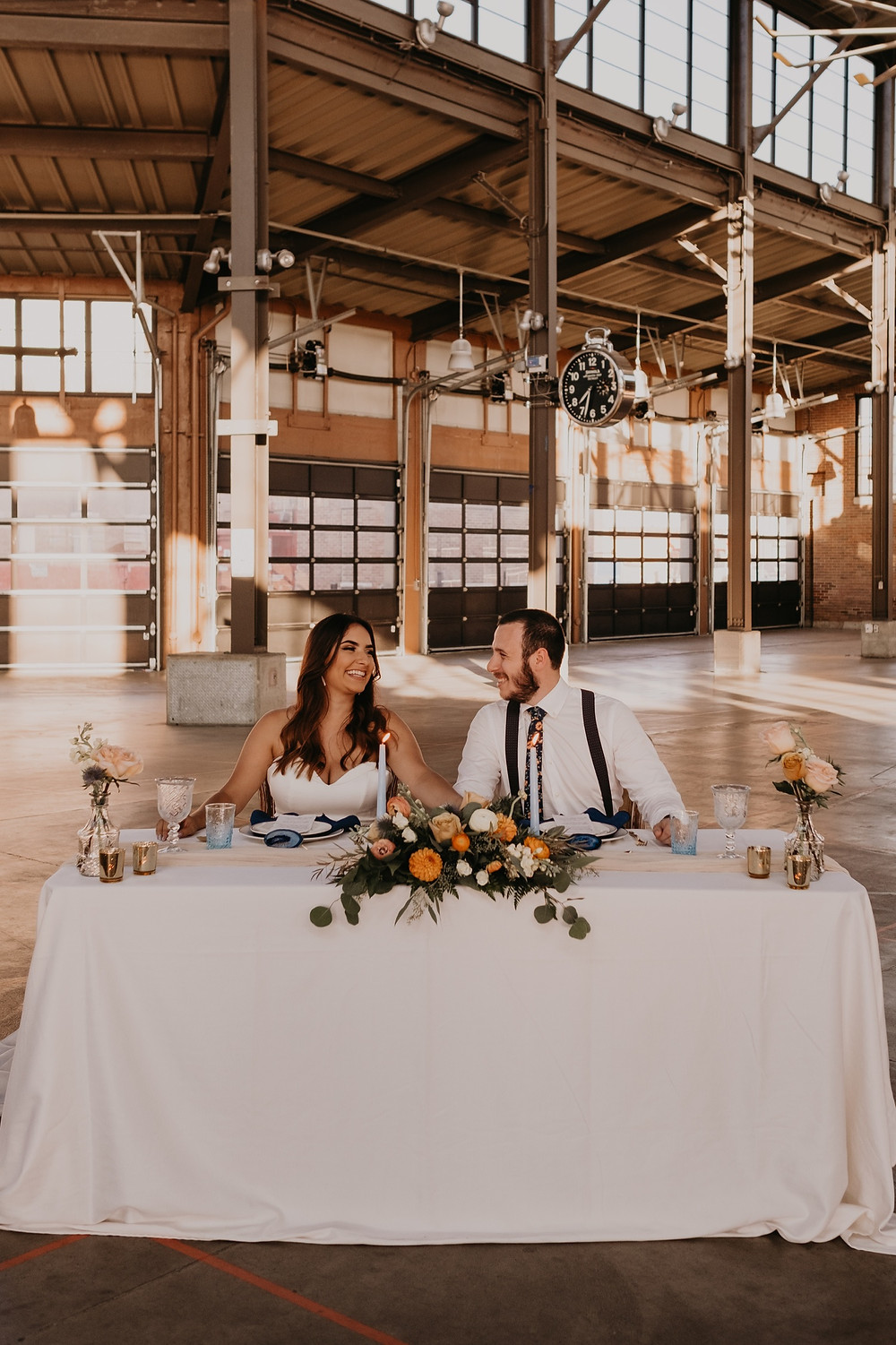 Couple at head table in Eastern Market Detroit. Photographed by Nicole Leanne Photography.