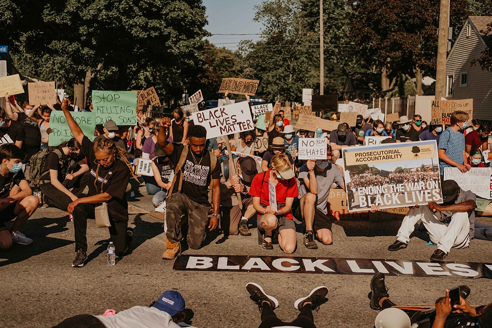 Protesters take a knee for George Floyd in Michigan city Berkley