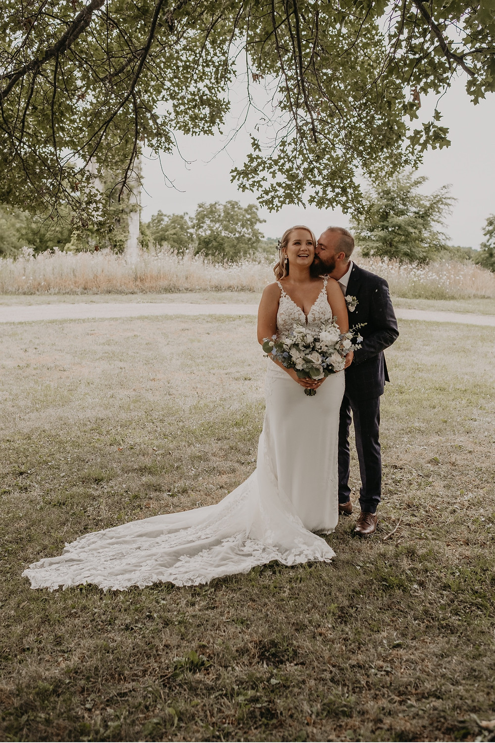 Wedding photos outside in Metro Detroit. Photographed by Nicole Leanne Photography.