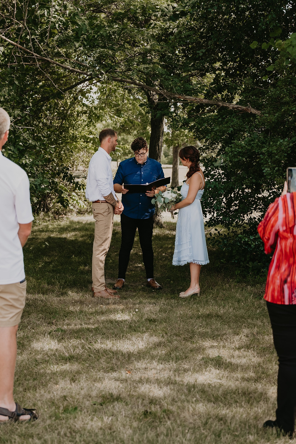 Intimate wedding ceremony with bride and groom at Metro Detroit park. Photographed by Nicole Leanne Photography.