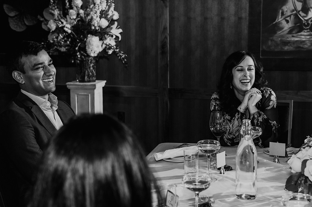 Guests at wedding laughing and smiling. Photographed by Nicole Leanne Photography.