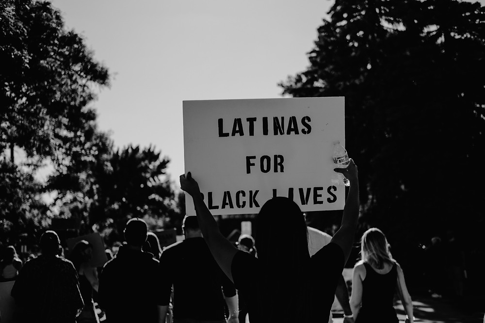 Protest sign reads Latinas for Black Lives