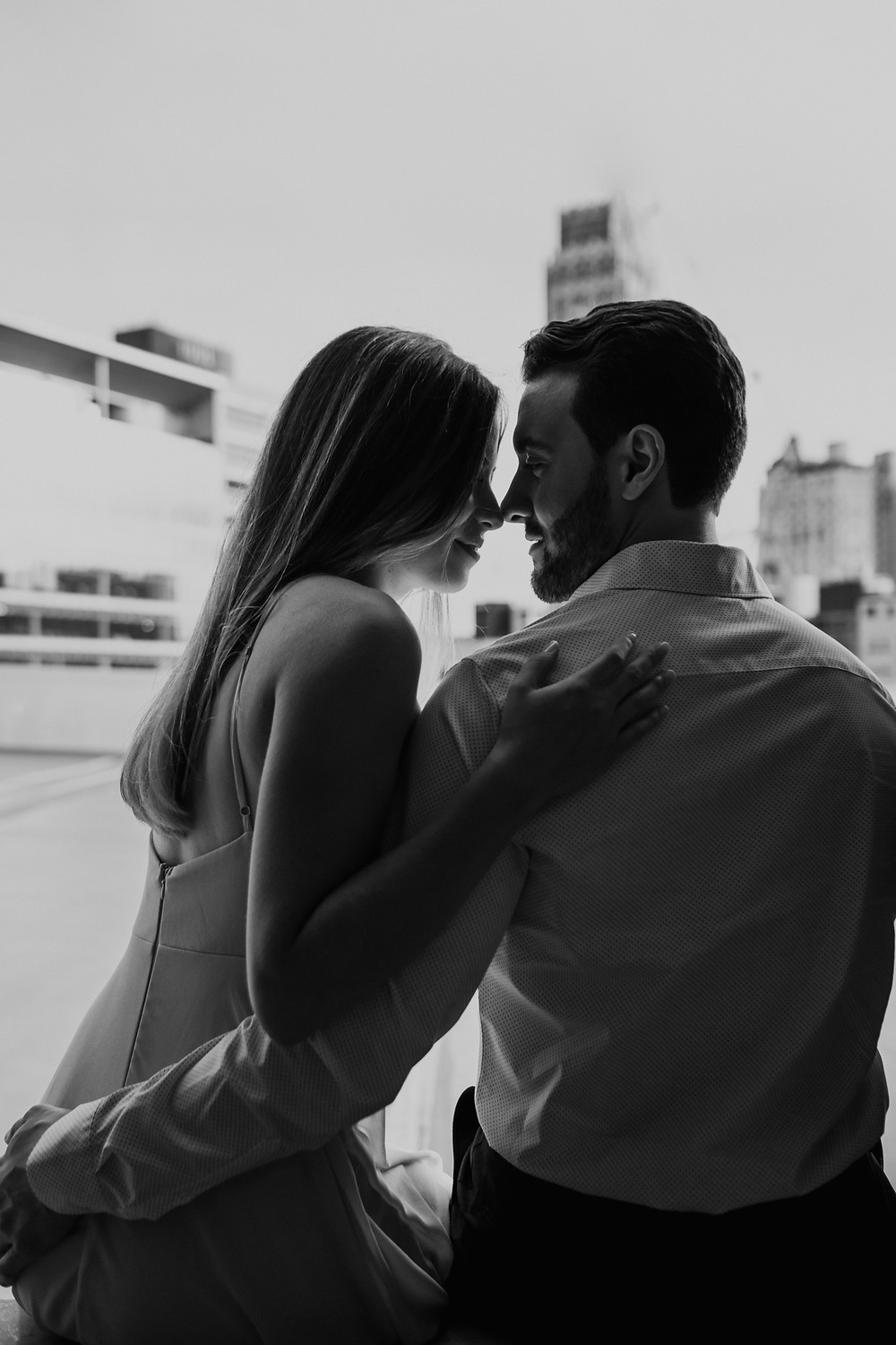 Black and white silhouette of couple. Photographed by Nicole Leanne Photography.
