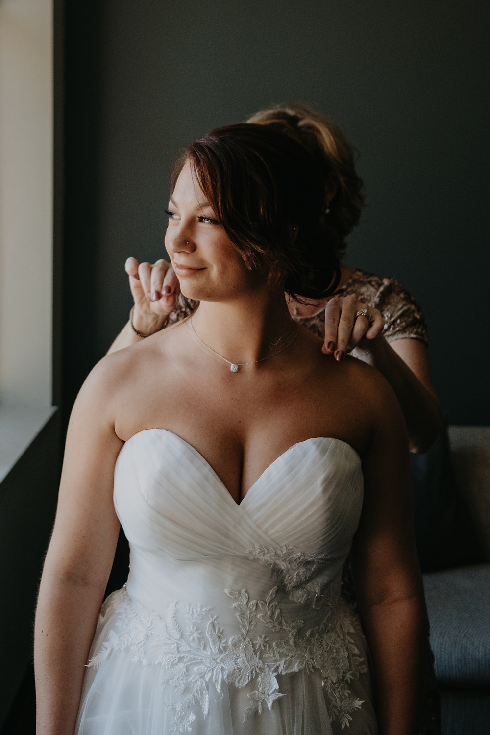 Bride getting dressed on wedding day. Photographed by Nicole Leanne Photography.