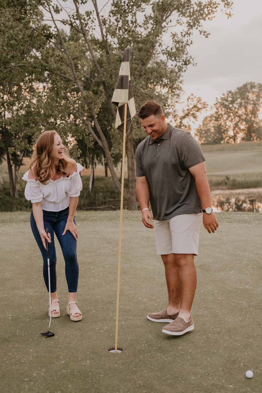 Golf course engagement photos in Metro Detroit. Photographed by Nicole Leanne Photography