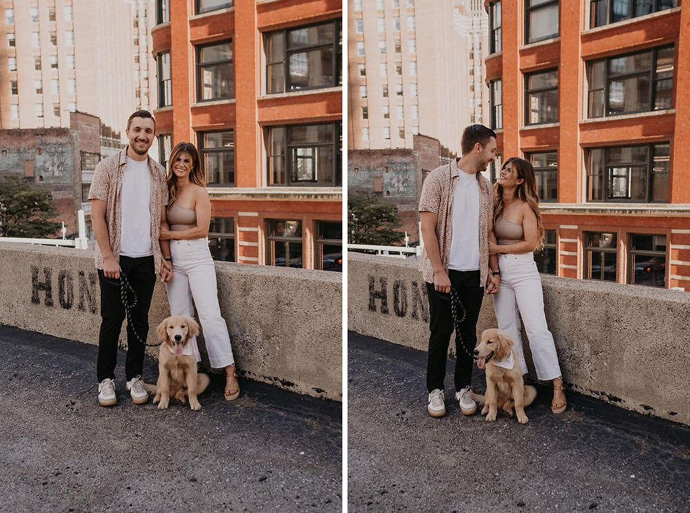 Couple posing with dog on Detroit rooftop. Photographed by Nicole Leanne Photography.