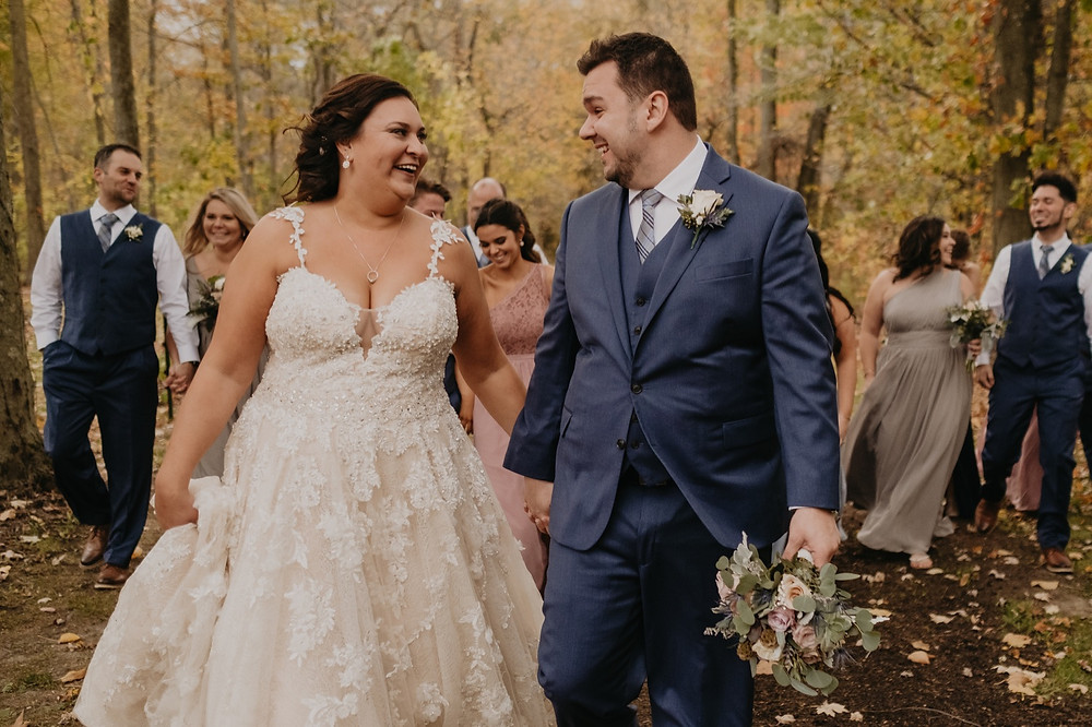 Michigan fall wedding photos in woods with colorful trees