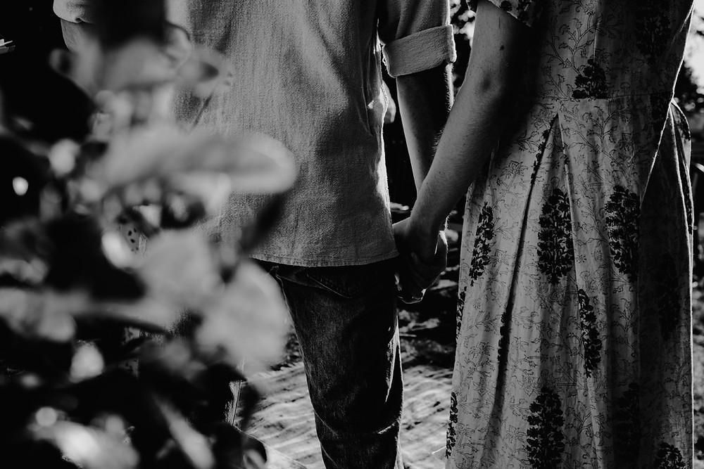 holding hands, outdoor wedding