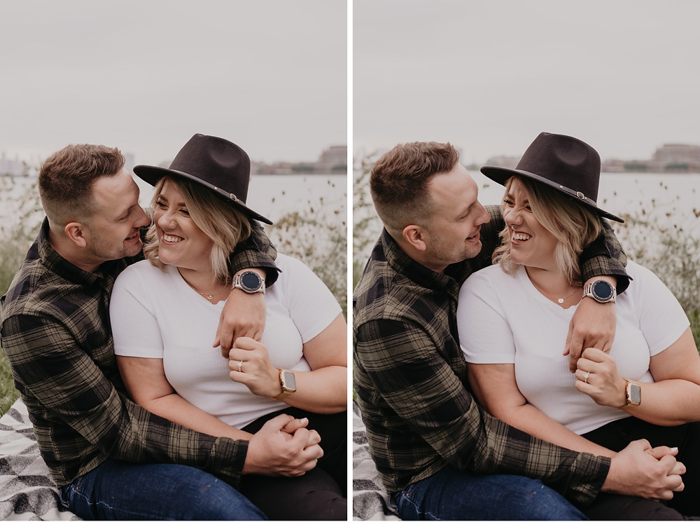 Couple with arms around each other at Detroit Riverwalk photo session. Photographed by Nicole Leanne Photography.