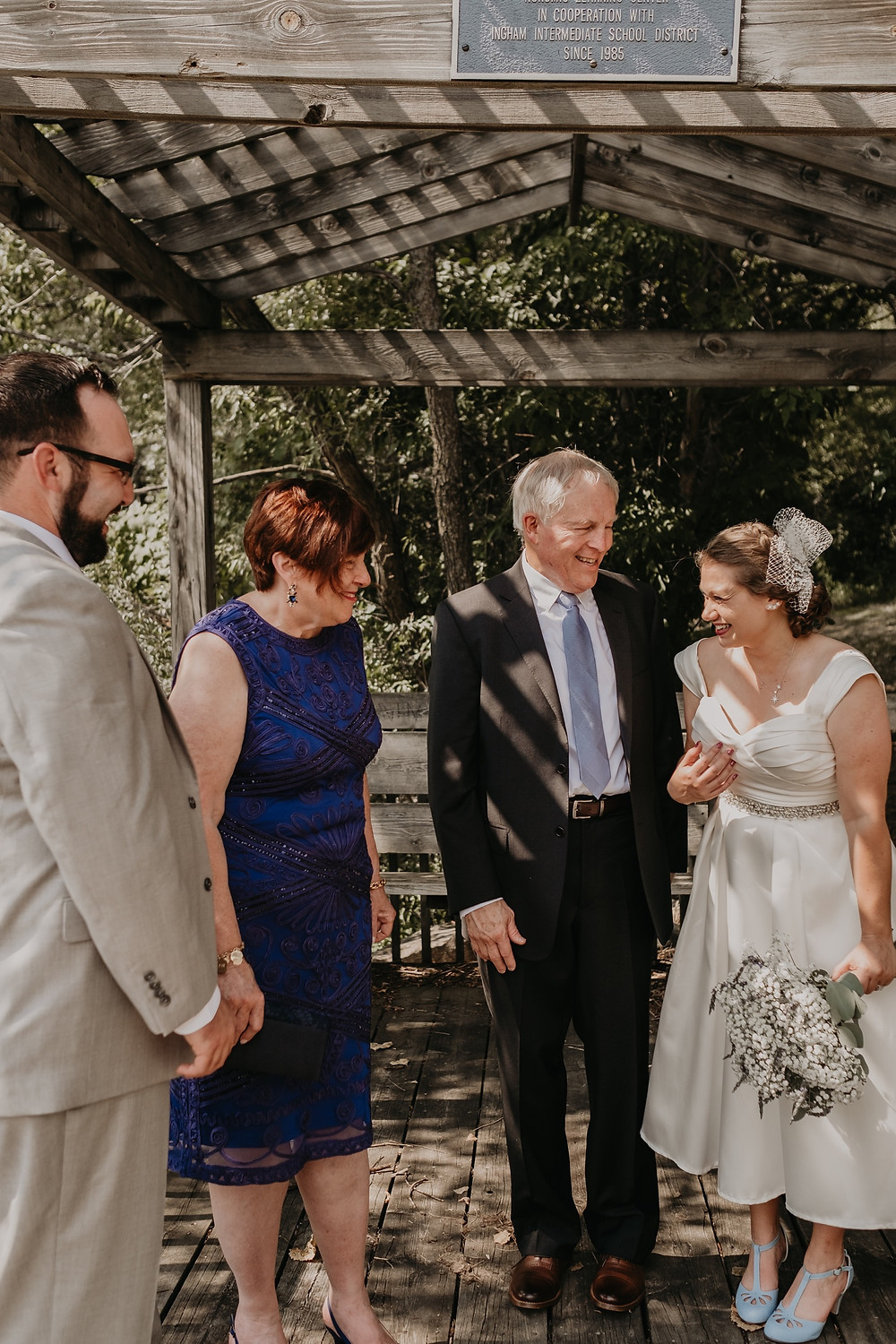 Bride and groom greeting guests after wedding ceremony. Photographed by Nicole Leanne Photography.