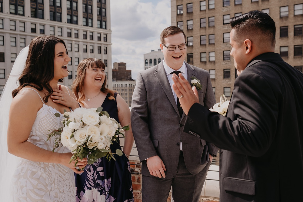 Wedding day candids at Detroit wedding. Photographed by Nicole Leanne Photography.