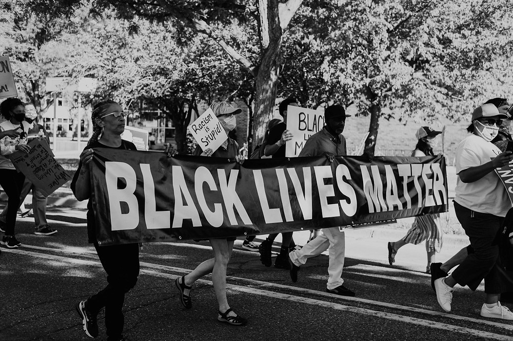 Protestors walk with black lives matter banner during Berkley Michigan protest