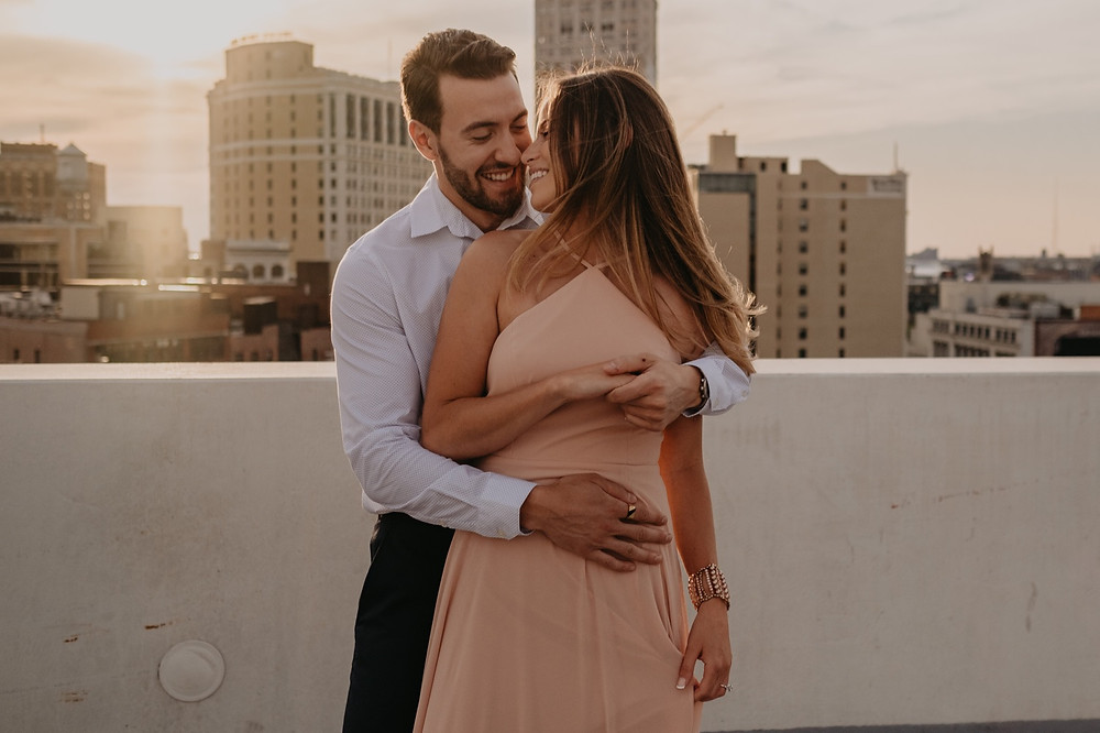 Sunset engagement photos in downtown Detroit. Photographed by Nicole Leanne Photography.
