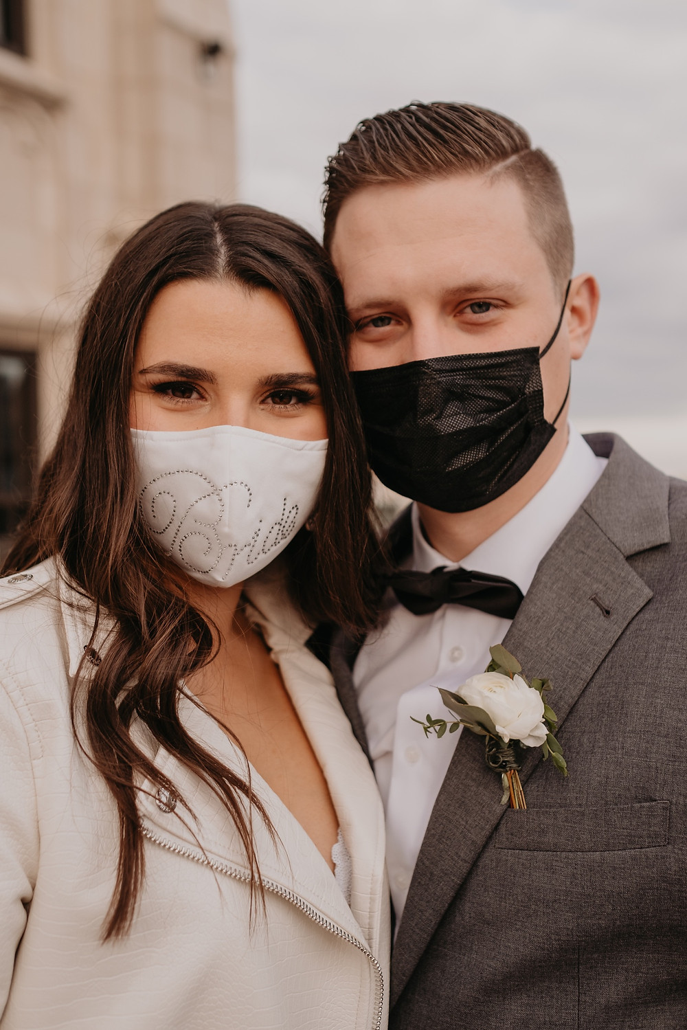 Bride and groom wearing face masks during 2021 pandemic wedding. Photographed by Nicole Leanne Photography.