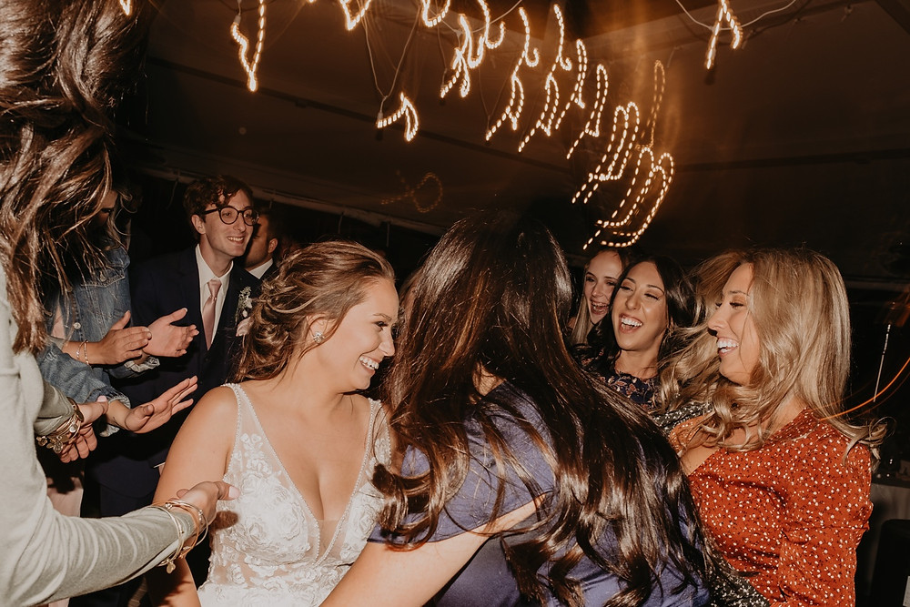 Bride dancing with guests. Photographed by Nicole Leanne Photography.