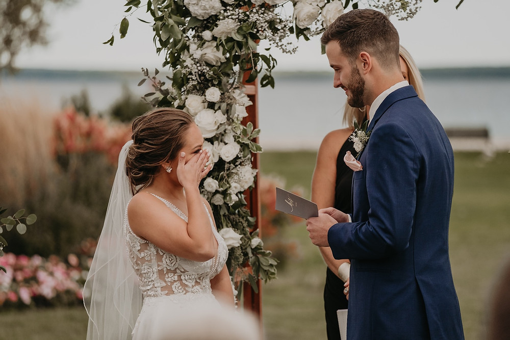 Groom reading vows. Photographed by Nicole Leanne Photography.