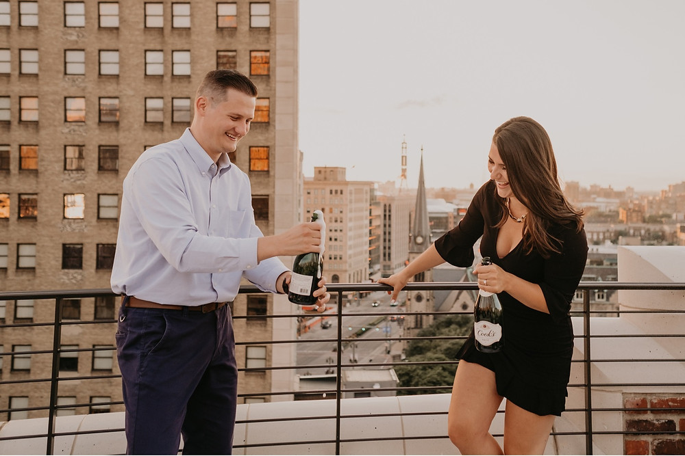 The Monarch Club rooftop champagne toast in Detroit. Photographed by Nicole Leanne Photography.